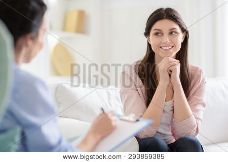 Smiling Woman Talking To Wellness Coach About Motivation And Happiness, Free Space