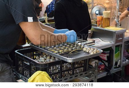 A Man Cracked Quail Eggs To Cooking