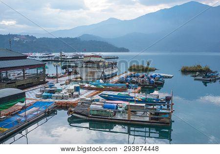 Boat And Speed Boat Dock Yard In Sunrise Morning At Sun Moon Lake , Taiwan