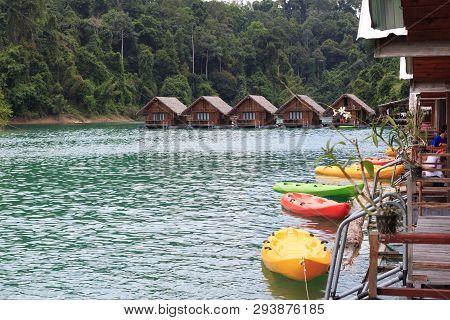Relaxing Green Canoeing In Lake Hut Resort