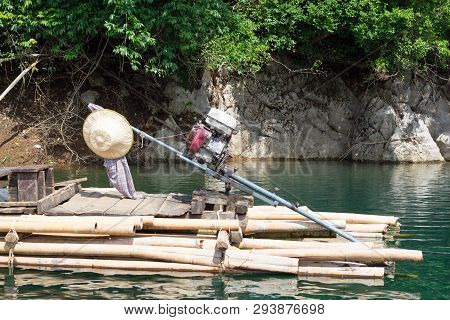 The Wooden Floating Raft With Motor In River