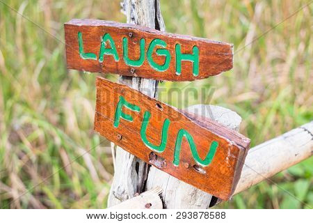 Fun And Laugh Text In Wooden Sign
