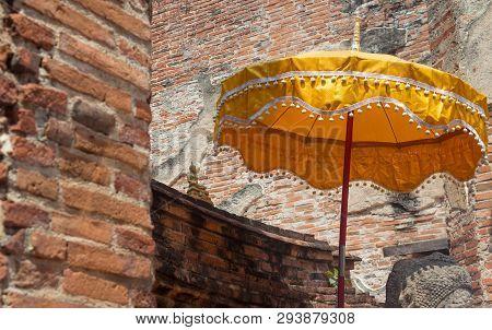 Orange Long Handled Buddhist Umbrella In  Church Temple