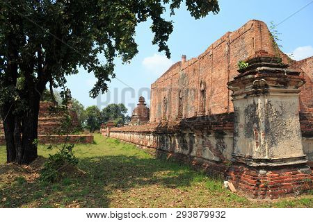 Old Ancient Brown Brick Wall Temple In Thailand