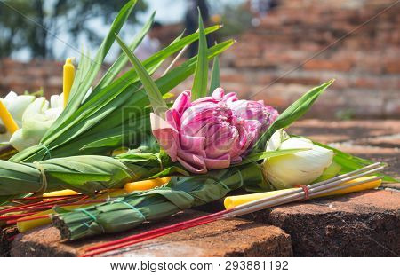 Incense Candle And Pink Lotus For Pray On Ancient Brick Wall Temple