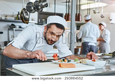 We Know How To Cook. Chef Cook Preparing Japanese Food In Modern Commerical Kitchen
