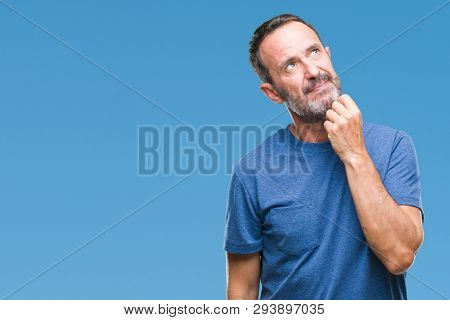 Middle age hoary senior man over isolated background with hand on chin thinking about question, pensive expression. Smiling with thoughtful face. Doubt concept.