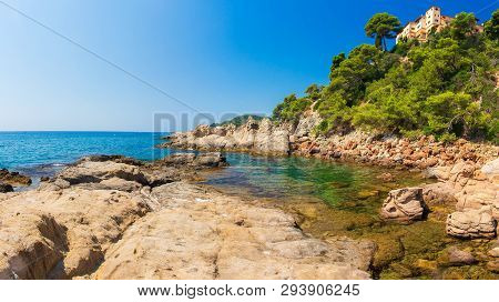Spain Sea Landscape. Spanish Coast With Rocky Beach On Clear Day. Amazing Seascape Of Mediterranean