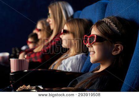Row Of People In Cinema Sitting, Watching Movie Or Cartoon. Cute, Pretty Girl Wearing In 3d Glasses