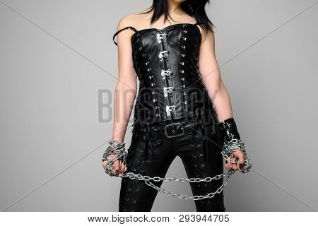 Sensual Woman In Black Leather Corset And Pants With Chain In Hand - Image