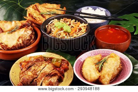 Assorted Chinese food set. Chinese noodles, fried rice, peking duck, dim sum, spring rolls. Famous Chinese cuisine dishes on table. Chinese restaurant concept. Asian style banquet poster