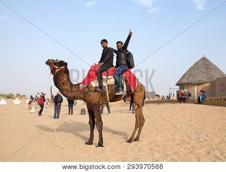 Bikaner, India - January 12, 2019: Tourists Riding On Camel In Tahr Desert In Rajasthan State