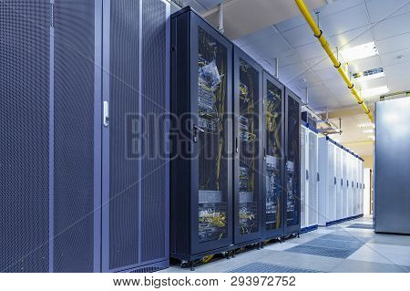 Server Internet Datacenter Room With Rows Of Modern Mainframes. Server Control Center For Internet P