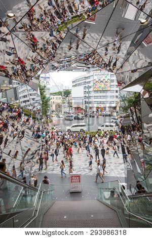 Tokyo, Japan - 19 June 2016: The mirrored entrance to the Tokyu Plaza shpping mall in Omotesando Harajuku, Tokyo.