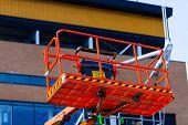 Elevating crane basket for engeneer. Industry concept with construction site elevating crane. poster
