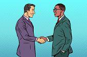 African and Caucasian businessmen men handshake. Pop art retro vector illustration vintage kitsch 50s 60s poster