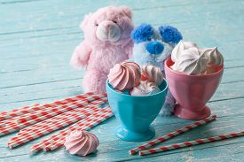 Sweet Dessert. Multicolored Air Meringues In A Round  Vase,  On A Wooden Table.