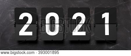 New Year 2021. White Digits From Split Flap Airport Letters On Black Background, Banner. 3D Illustra