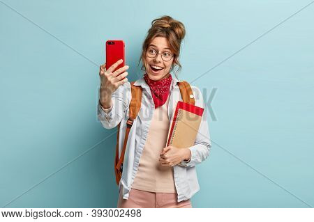 Smiling Good Looking Woman Makes Selfie Via Cell Phone, Being In High Spirit, Enjoys Free Time After