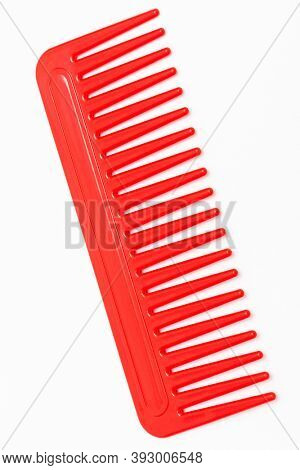 new red comb on a white background