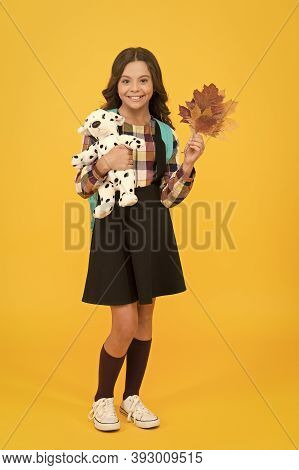 Childhood Is Full Of Learning. Happy Little Schoolgirl Hold Childhood Toy And Autumn Leaves. Small C