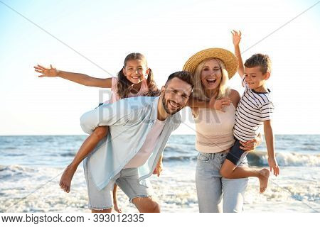 Happy Family On Beach Near Sea. Summer Vacation