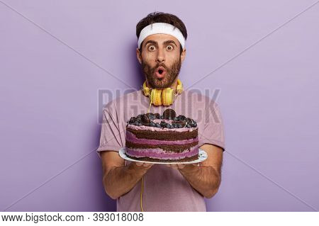 Astonished Handsome Guy With Bristle, Dark Hair, Stare At Camera, Has Wide Opened Eyes And Mouth, Ho