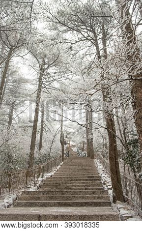 The Stairs Walkway Is Cover Of Snow At The Huangshan Mountain Or Yellow Mountain, The Mountain Range