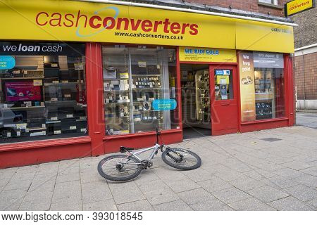 Doncaster, Yorkshire, England - October 7, 2020. Doncaster Cash Converters With A Bicycle Left On Th