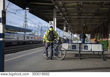 Doncaster, Yorkshire, England - October 7, 2020.caucasian Man Standing Next To His Bicycle Held By A
