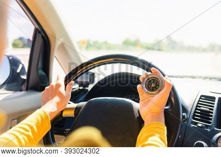Asian Woman Inside A Car And Using Compass To Navigate While Driving The Car She Find Navigation Loc