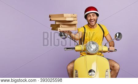 Friendly Punctual Pizza Delivery Man Has Nice Time Management Skills, Poses On Motorbike, Wears Prot