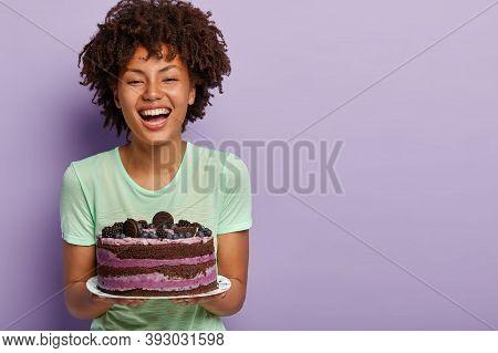 Happy Birthday Girl Laughs Joyfully, Holds Big Tasty Fruit Cake, Likes Eating Sweet Food, Improves M