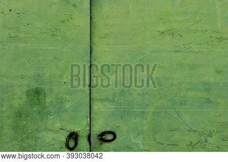 Detail Of Green Wooden Door With Ancient And New Door Lock - Old Traditional Green Wooden Door And A