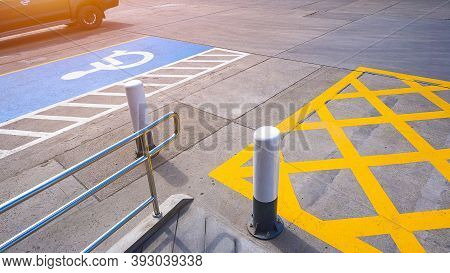 No Parking Sign With Disabled Wheelchair And Railing On Concrete Ground Surface In Parking Lot Of Pu
