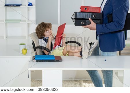 Little Boss. Little Businessman Bossy Child Working In Office. Business Partners Discussing Plans. F