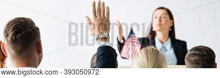 Political Agitator Pointing With Hand At Voters In Conference Hall On Blurred Background, Banner