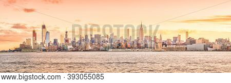 New York City Skyline At Sunset In Usa