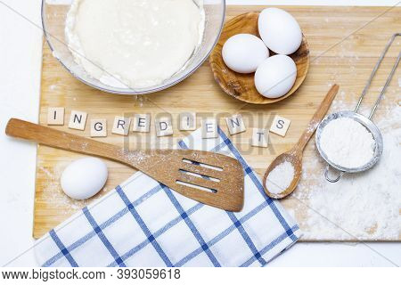 Preparation Of Dough For Home Pancakes For Breakfast. Ingredients On The Table Wheat Flour, Eggs. In