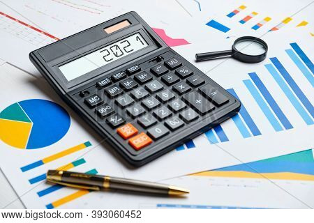 Financial Concept In 2021 On A Calculator And Graphs.