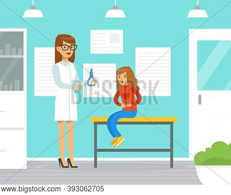 Little Girl With Stomachache At Doctors Consulting Room With Woman Pediatrician Giving Prescription