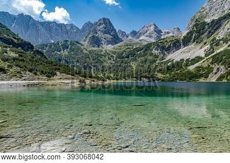 The Seebensee Near Ehrwald In Tyrol / Austria. It Is One Of The Most Beautiful Mountain Lakes In Tyr