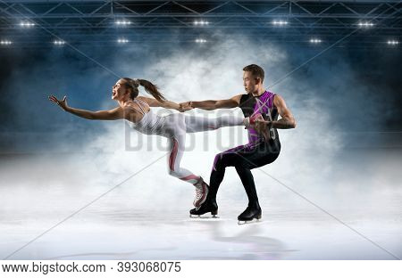 Duo figure skating in action on dark background. Sports banner. Horizontal copy space background