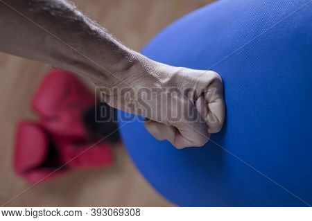 A Bare Knuckle Training With Boxing Bag