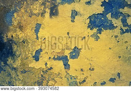 Yellow Grunge Wall With Paint Peeling Off. Toned Image.
