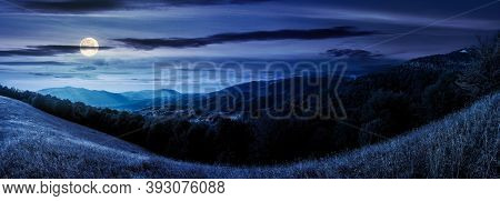 Mountainous Countryside At Night. Beautiful Panorama Of Carpathians. Valley Of Borzhava Ridge In The