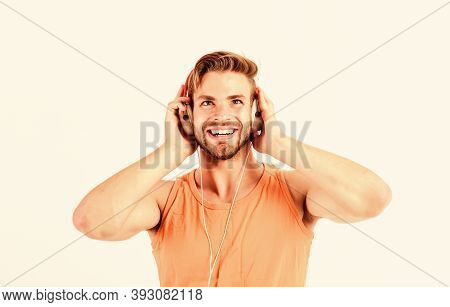 Man Handsome Bearded Guy Listening Music Headphones White Background. Audiovisual Spectacular. Melod