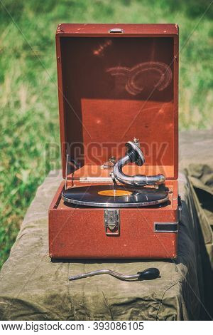 An Old Portable Gramophone Plays A Vinyl Record