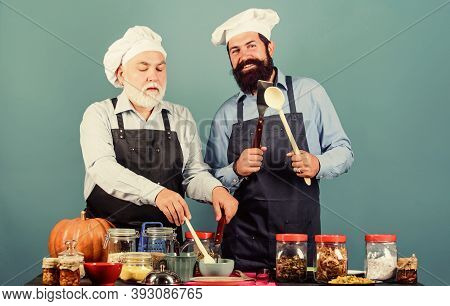 Culinary Book. Mature Bearded Men Professional Restaurant Cooks. Chef Men Cooking. Father And Son Cu