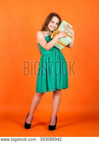 Shopping Happiness. Holidays Concept. International Childrens Day. Joyous Female Kid Holding Gift-wr
